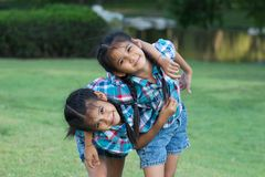 Twins Kids playing in park Royalty Free Stock Images