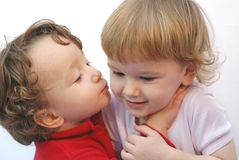Twins kiss. Child kissing her twin sister Royalty Free Stock Photography