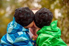 Twins Kissing his Father Stock Photography