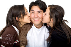 Twins kissing a man Royalty Free Stock Photography