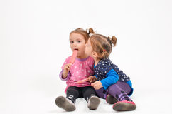 Twins kissing Royalty Free Stock Photos