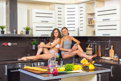 Twins in kitchen Royalty Free Stock Photos