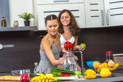 Twins in kitchen Stock Image