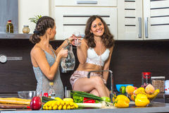 Twins in kitchen Stock Photography