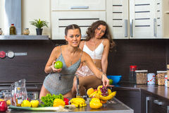 Twins in kitchen Royalty Free Stock Images