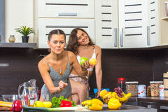 Twins in kitchen Royalty Free Stock Image