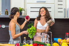 Twins in kitchen Stock Photos