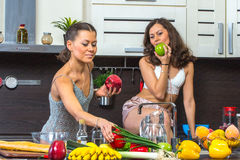 Twins in kitchen Royalty Free Stock Photography