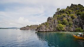 Coron, Philippines - January 5, 2018: Twins lagoon with cliffs. Coron. Palawan. Philippines. stock video footage