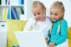 Twins with laptop Royalty Free Stock Photo
