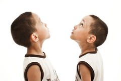 Twins looking up Stock Images