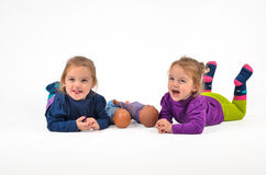 Twins lying on a belly Royalty Free Stock Image