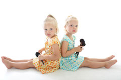 Twins with make-up brushes royalty free stock photography