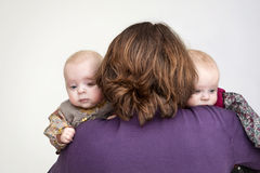 Twins and mother. Twin girls in mother's arms Stock Image