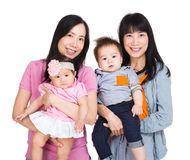 Twins mother with baby daughter and son Stock Photos
