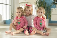 Twins and elder sister sitting at home royalty free stock image