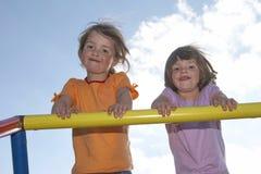 Twins On Climbing Pole 03 Royalty Free Stock Image