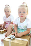 Twins packing presents Stock Images