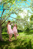 Twins in pink doll style Stock Photography