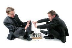 Twins play a chess Royalty Free Stock Photo