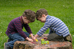 Twins play with enthusiasm stock images