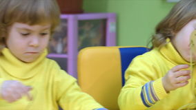 Twins play in a logical toy. Four-year-old children in the classroom for intellectual development medium close up stock footage