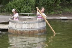 Twins playing in a barrel 04 Stock Photos