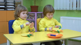 Twins playing an educational game stock video footage