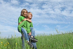 Twins playing piggyback Stock Photography