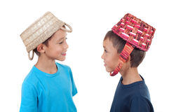 Twins playing with wicker baskets Royalty Free Stock Image