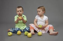 Twins portrait. Portrait of cute twins with apples Royalty Free Stock Photo