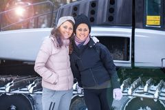 Sisters posing on ski resort Stock Images