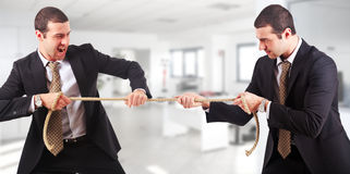 Twins pulling a rope Stock Photography