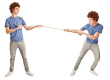 Twins pulling a rope Royalty Free Stock Photo