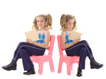 Twins reading Royalty Free Stock Photo