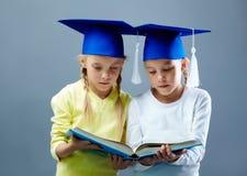 Twins reading Stock Photo