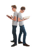 Twins reading books. Identically adult male twins standing and reading books Royalty Free Stock Photography