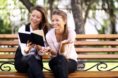 Twins of sister readink book Royalty Free Stock Photos