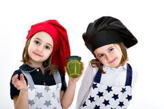 Twins sisters cook chef with pesto genovese Stock Photography
