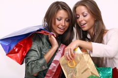 Twins sisters holding shopping bags Stock Images