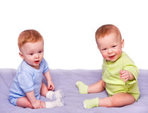 Twins sit the friend Royalty Free Stock Image