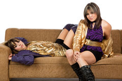 Twins sitting on a sofa isolated against white Stock Photo