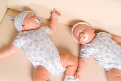 Twins sleeping on sofa Royalty Free Stock Image