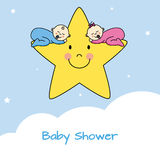 Twins sleeping in a star Royalty Free Stock Image