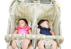 Twins sleeping in their stroller Royalty Free Stock Images