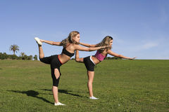 Twins stretching Stock Photos