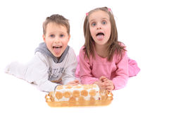 Twins and sweet cake Royalty Free Stock Photo