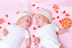 Twins and sweets Royalty Free Stock Images
