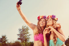 Twins taking a photo. Of themselves on the beach Stock Image