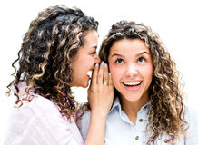 Twins telling a secret Stock Images